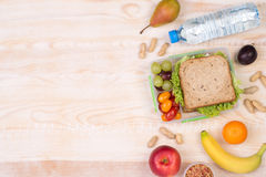 Lunchbox with sandwich, fruits, vegetables, and water with copy space Royalty Free Stock Photo