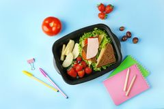 Lunchbox with tasty dinner and stationery Stock Photos