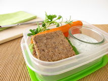 Lunchbox with wholemeal bread and carrots Royalty Free Stock Photos