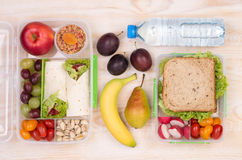 Lunchboxes with sandwiches, fruits, vegetables, and water Royalty Free Stock Photo