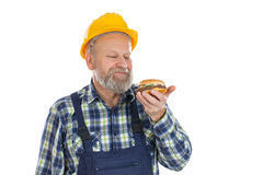 Lunchbreak - hamburger. Picture of a hungry mechanic having a lunch break, eating hamburger Stock Photography