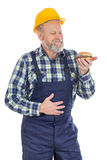 Lunchbreak - hamburger. Picture of a hungry mechanic having a lunch break, eating hamburger Royalty Free Stock Photo
