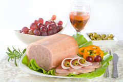 Luncheon meat. Salad, olives and grapes Royalty Free Stock Image