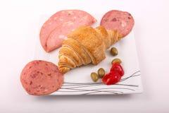 Luncheon meat avec le croissant Photos stock