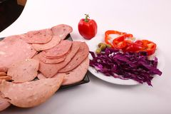 Luncheon meat with salad. Variety of luncheon meat on dish with white background Royalty Free Stock Images