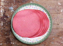 Luncheon meat. Slices of luncheon meat on plate Royalty Free Stock Images