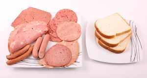 Luncheon meat with Toast. Variety of luncheon meat on dish with  Toast on white plate on white background Royalty Free Stock Photos