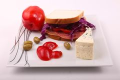 Luncheon Sandwich. Mortadella luncheon meat with blue cheese toast with olive, tomato and pepper as breakfast meal Stock Image
