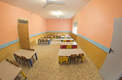Lunchroom of the refectory of the kindergarten with small benche. Lunchroom of the refectory of the kindergarten with benches and chairs Royalty Free Stock Photos