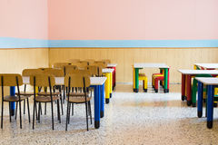 Lunchroom of the refectory of the kindergarten with small benche. S and small chairs Royalty Free Stock Photos