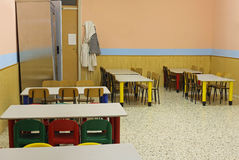 Lunchroom school without kids with colorful chairs and small tab Royalty Free Stock Photo