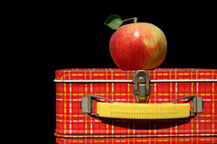 Lunchtime. Vintage lunchbox with apple on top Royalty Free Stock Photography