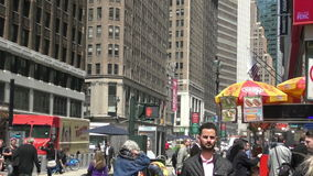 Lunchtime crowds New York City. New York, USA - April 24, 2015: Crowds fill the streets on new York City at lunch time near Herald Square stock video