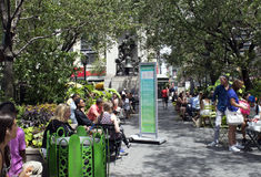 Lunchtime in Herald Square in New York City. People relax and eat lunch in Manhattan's Herald Square at 34th and Broadway Royalty Free Stock Photo