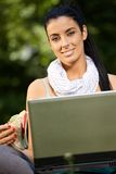 Lunchtime portrait of young woman with laptop Royalty Free Stock Photo