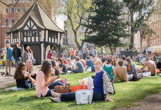 Lunchtime. Relaxing at Soho Square, London, a popluar lunchtime venue for workers in the area Royalty Free Stock Images