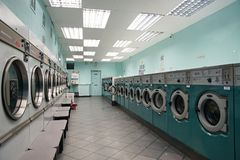 Lunderette with washmachines. Green Color. Royalty Free Stock Photo