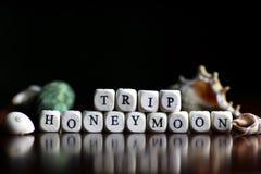 Lune de miel de cube en textes Photographie stock