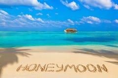 Lune de miel de Word sur la plage Photographie stock libre de droits
