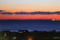 Lune neuve de coucher du soleil Image stock