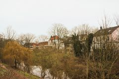 Luneburg, Germany - 10.12.2017: Medieval traditional European houses and Ilmenau river. Winter in Europe. Luneburg, Germany - 10.12.2017: Medieval traditional stock photography