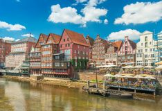 Luneburg, Germany: View of the embankment with old historical houses in traditional German architecture style. Luneburg - July 2018, Germany: View of the stock photo