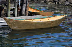 Lunenburg Dories. Two traditional yellow dories at dock. The water from the harbour is reflecting off the side of the one in the foreground Royalty Free Stock Images