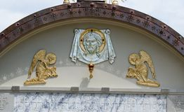 Lunette on Orthodox church with face of Jesus and two angels. In Kyiv, Ukraine Royalty Free Stock Images