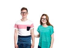 Lunettes de port d'adolescent et de fille Tir de studio, d'isolement Photos libres de droits