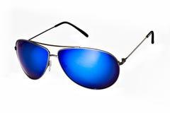 Lunettes de soleil élégantes de mode avec les lentilles bleues Image libre de droits