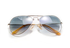 Lunettes de soleil d'isolement de style d'aviateur Photographie stock libre de droits