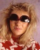 Lunettes de soleil de partie supérieure de femme Photos stock