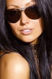 lunettes de soleil sexy de brunette Images libres de droits