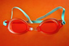 Lunettes oranges de natation photographie stock