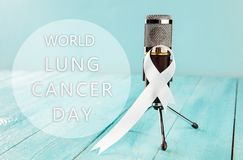 Lung cancer ribbon, white ribbon, a symbol of the fight against lung cancer. The white ribbon, a symbol of the international or world day of fight against lung stock photo