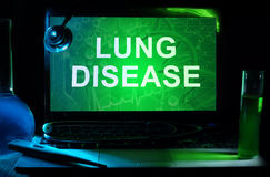 Lung Disease. Notebook with words  Lung Disease, test tubes and stethoscope Royalty Free Stock Images