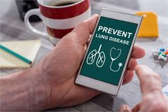 Lung disease prevention concept on a smartphone Stock Photos