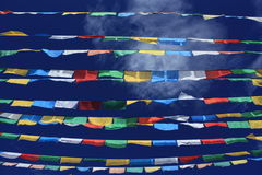 Lung Ta (Prayer Flags). Tibetan Buddhism prayer flags in five colors, against the blue sky Stock Photos