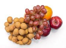 Lungan, uva, arancio, mela Immagine Stock