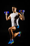 Lunge with dumbbells Royalty Free Stock Photo