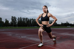 Lunge Exercise For Quadriceps By Athlete On Track Stock Images
