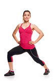 Lunge exercise pose. Woman wearing dark leggings and bright short top doing lunge fitness, white. full length stock photography