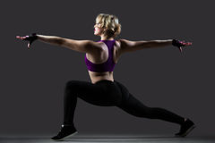 Lunge exercises with stretched arms Stock Photos