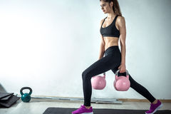 Lunge with rose kettlebell Stock Image