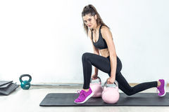 Lunge with rose kettlebell Stock Photos