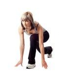 lunging sportswoman Стоковые Изображения