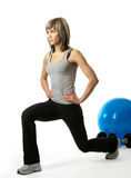 lunging sportswoman Стоковые Фотографии RF