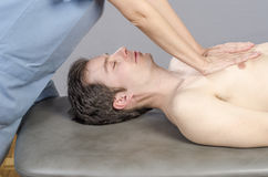 Lungs massage. Physiotherapist/ chiropractor is doing a lungs massage Stock Photos