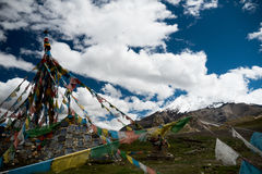 Lungta and glacier on high mountain in Himalayas Tibet Royalty Free Stock Photography