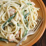 Lunguini shrimps and zucchini with cream. Close up royalty free stock images